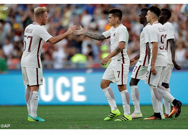 Roma's Manuel Iturbe is congratulated by team mates after scoring during a friendly football match in Rome - AP