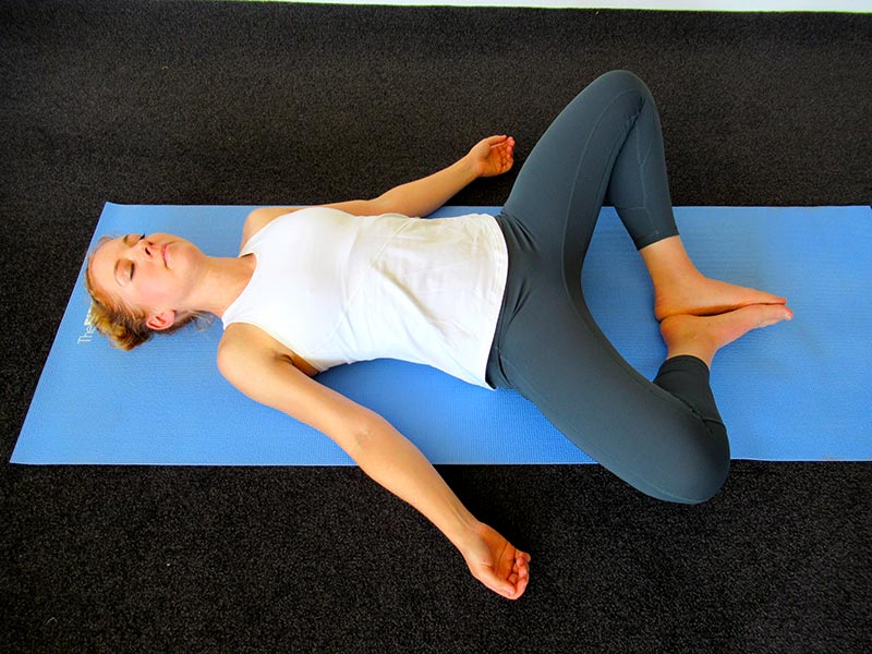 Reclining bound angle yoga pose for stress relief
