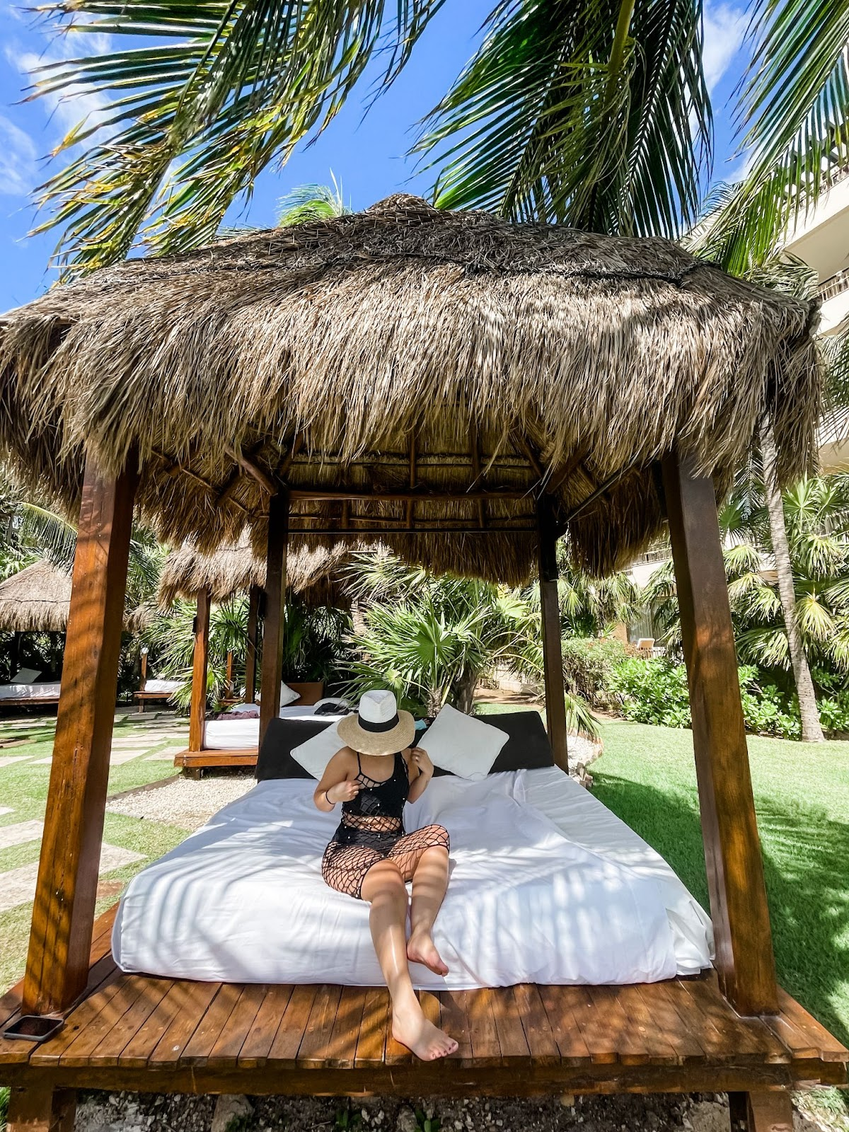 woman sitting in a cabana to disconnect from work