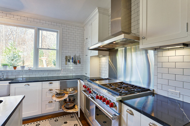 contemporary white kitchen with a blind corner cabinet and pull out shelving for pots and pans