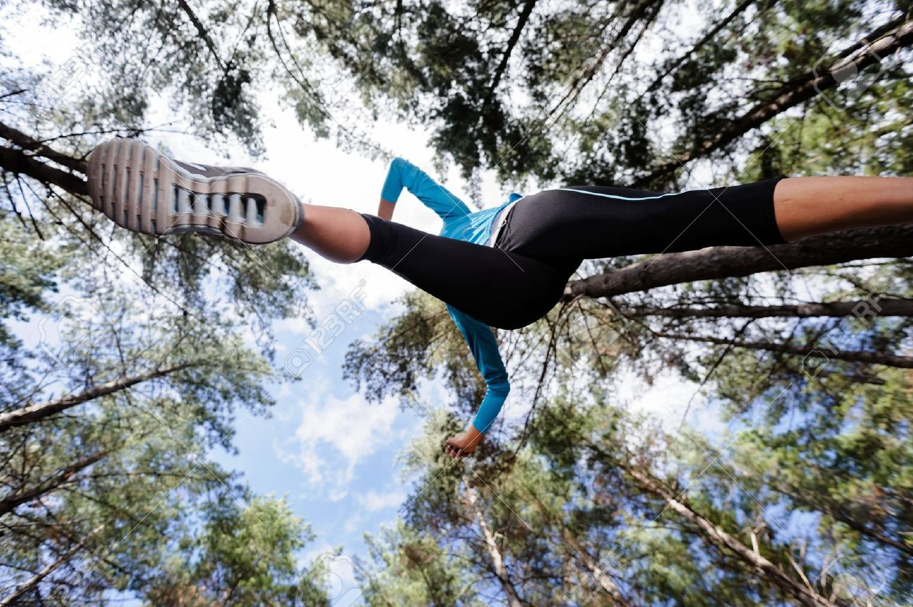14342256-low-angle-view-of-runner-jumping-and-running-in-forest-healthy-active-lifestyle--Stock-Photo.jpg