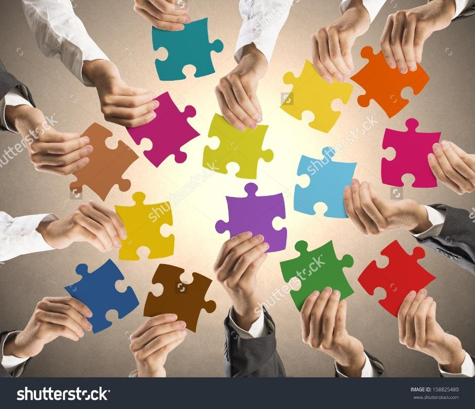 http://image.shutterstock.com/z/stock-photo-concept-of-teamwork-and-integration-with-businessman-holding-colorful-puzzle-158825480.jpg