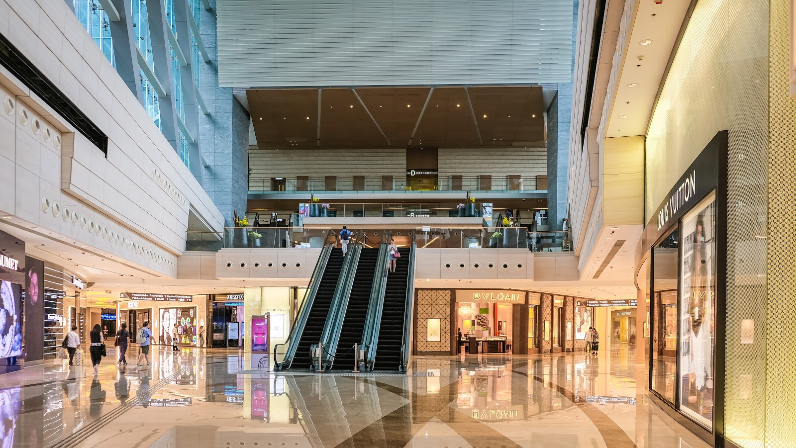 Customers walk in a mall, use escalators, and get navigation from their phones using beacons to the stores they're going to.
