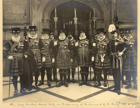 12 men in traditional British Beefeater guard costume in 1901 as they are about to reenact the Guy Fawkes search